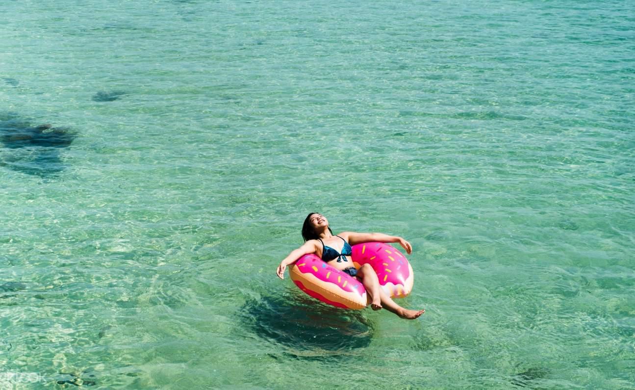 woman paddleboarding island